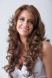 Beautiful smiling woman with healthy long curly hair Royalty Free Stock Photo
