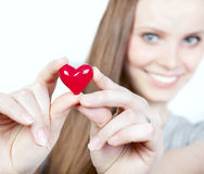 Beautiful smiling woman with heart Stock Images