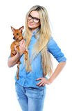 Beautiful smiling woman holding her little puppy isolated on while. Beautiful smiling woman holding her little puppy isolated stock image