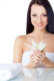 Beautiful smiling woman holding lily flower Stock Photography