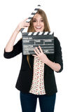 Beautiful smiling woman holding a movie clapper. Royalty Free Stock Photo