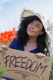 Beautiful smiling woman holding a paper banner with text Royalty Free Stock Image