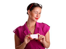 Beautiful smiling woman holding a white card Stock Image