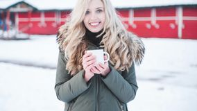 Beautiful smiling woman holds a cup of hot cocoa. stock photography
