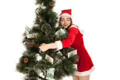 Beautiful smiling woman hugging fir tree. Beautiful smiling woman hugging money fir tree Royalty Free Stock Photography