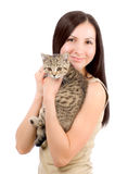 Beautiful smiling woman with a kitten in her arms Royalty Free Stock Image