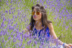 Beautiful smiling woman in lavender garden Stock Photo