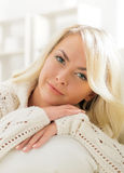 Beautiful smiling woman laying on a pillow in the morning Royalty Free Stock Image