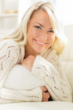 Beautiful smiling woman laying on a pillow in the morning Stock Image