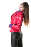 Beautiful smiling woman in leather pants. Stock Photos