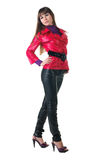 Beautiful smiling woman in leather pants. Royalty Free Stock Photography