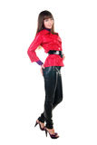 Beautiful smiling woman in leather pants. Stock Photo