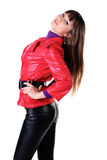 Beautiful smiling woman in leather pants. Royalty Free Stock Photos