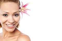 Beautiful smiling woman with a lily Stock Photos