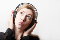 Beautiful smiling woman listening music in headphones Stock Photos