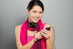 Beautiful smiling woman listening to music Royalty Free Stock Images