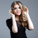 Beautiful smiling woman listening to music Royalty Free Stock Photo