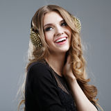 Beautiful smiling woman listening to music Stock Image