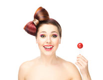Beautiful smiling woman with a lollipop Royalty Free Stock Image