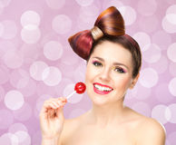 Beautiful smiling woman with a lollipop Royalty Free Stock Photography