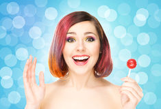 Beautiful smiling woman with a lollipop on bubble background Royalty Free Stock Image