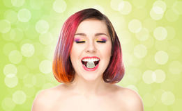 Beautiful smiling woman with a lollipop on bubble background Stock Photo