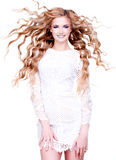 Beautiful smiling woman with long blond curly hair. Royalty Free Stock Photos