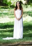 Beautiful smiling woman in long white dress Royalty Free Stock Images