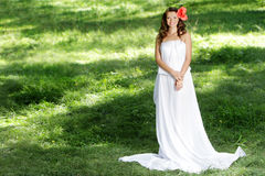 Beautiful smiling woman in long white dress Stock Photography
