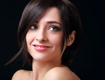 Beautiful smiling woman looking up. On black background Stock Photos