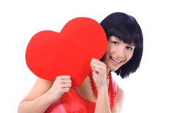 Beautiful smiling woman looks outred heart Royalty Free Stock Images
