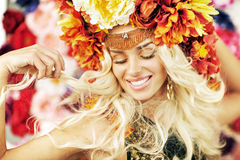 Beautiful smiling woman with a lot of flowers Stock Image