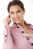 Beautiful smiling woman on mobile Stock Image