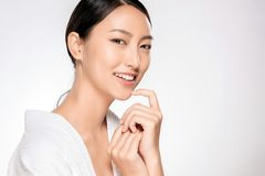 Beautiful smiling woman with natural make-up, clean skin. Beautiful Young asian Woman with Clean Fresh Skin look. Girl beauty face care. Facial treatment royalty free stock photography