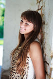 Beautiful smiling woman near the old wall Stock Photography
