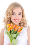 Beautiful smiling woman with orange flowers isolated on white Royalty Free Stock Photo