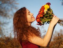 Beautiful smiling red haired woman outdoor. stock images
