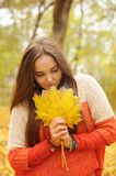 Beautiful smiling woman outdoor portrait, fresh skin and healthy smile, hold maple leaves bouqet front of face. Beautiful smiling woman outdoor portrait, fresh stock image