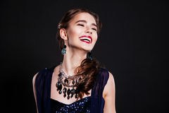 Beautiful smiling woman with perfect evening makeup wearing jewelry Stock Image
