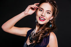 Beautiful smiling woman with perfect evening makeup wearing jewelry Royalty Free Stock Image