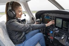 Free Beautiful Smiling Woman Pilot With Headset Sitting In Cabin Of Modern Aircraft Royalty Free Stock Photography - 152838707