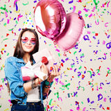 Beautiful Smiling Woman with Pink Balloons, Gift and Confetti Royalty Free Stock Photo