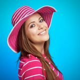 Beautiful smiling woman portrait on blue background Royalty Free Stock Images
