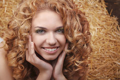 Beautiful smiling woman portrait with  curly hair Stock Images