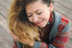 Beautiful smiling woman portrait dressed in gray knitted jersey Royalty Free Stock Photo