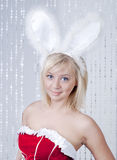 Beautiful smiling woman portrait with rabbit ears Stock Photos
