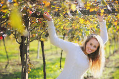 Beautiful smiling woman posing in a vineyard Stock Photos