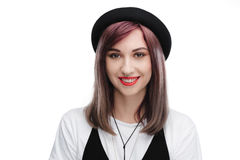 Beautiful smiling woman with purple hair wearing black hat, Royalty Free Stock Images