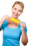 Beautiful smiling woman with raw corn Stock Images