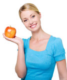 Beautiful smiling woman with a red apple Royalty Free Stock Photo